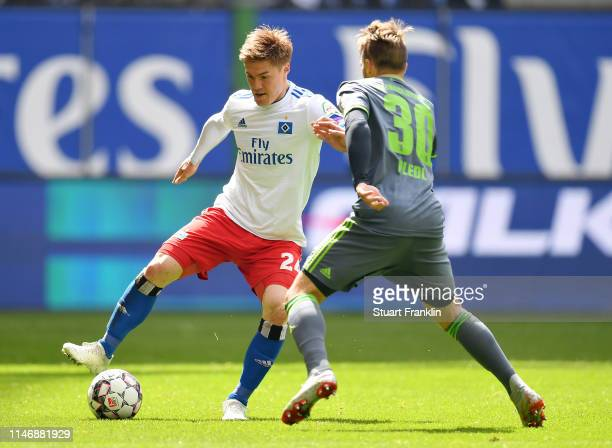 Gotoku Sakai of Hamburg is challenged by Thomas Pledl of FC Ingolstadt 04 during the Second Bundesliga match between Hamburger SV and FC Ingolstadt...