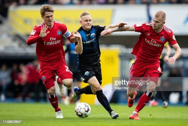 Gotoku Sakai of Hamburg Kai Proger of SC Paderborn and Rick van Drongelen battle for possession during the Second Bundesliga match between SC...