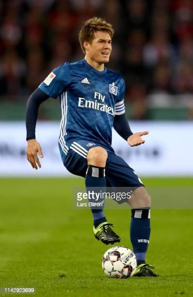 Gotoku Sakai of Hamburg runs with the ball during the Second Bundesliga match between 1 FC Koeln and Hamburger SV at RheinEnergieStadion on April 15...