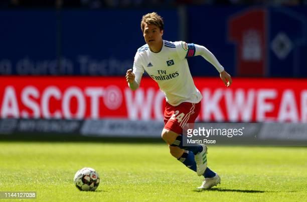 Gotoku Sakai of Hamburg runs with the ball during the Second Bundesliga match between Hamburger SV and FC Erzgebirge Aue at Volksparkstadion on April...
