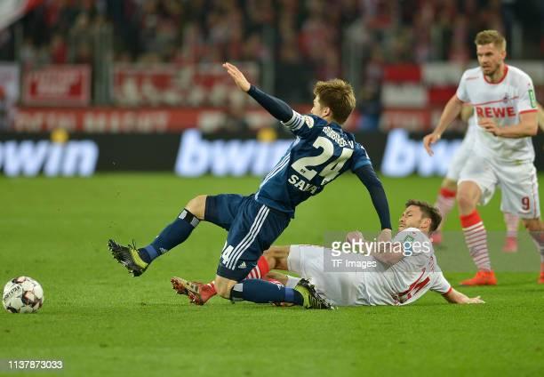 Gotoku Sakai of Hamburger SV and Jonas Hector of 1 FC Koeln battle for the ball during the Second Bundesliga match between 1 FC Koeln and Hamburger...