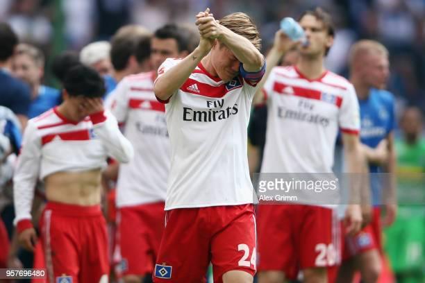 Gotoku Sakai of Hamburger SV and team mates react after his team is relegated after the Bundesliga match between Hamburger SV and Borussia...