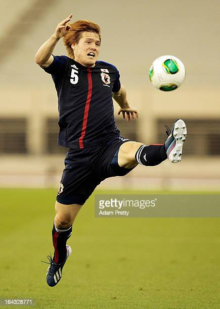Gotoku Sakai of Japan brongs down the ball during the international friendly match between Japan and Canada at Khalifa International Stadium on March...