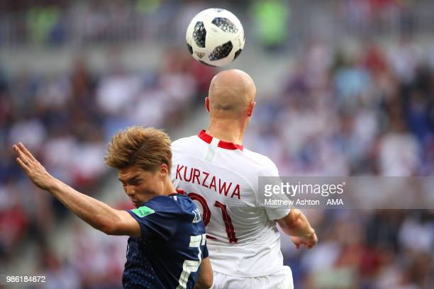 Gotoku Sakai of Japan competes with Rafal Kurzawa of Poland during the 2018 FIFA World Cup Russia group H match between Japan and Poland at Volgograd...
