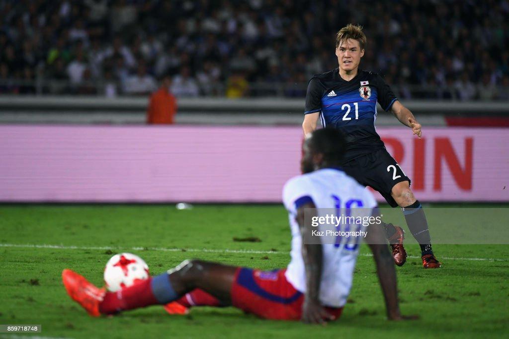 Gotoku Sakai of Japan shoots resulting in Japan's third goal scored by Shinji Kagawa during the international friendly match between Japan and Haiti at Nissan Stadium on October 10, 2017 in Yokohama, Kanagawa, Japan.