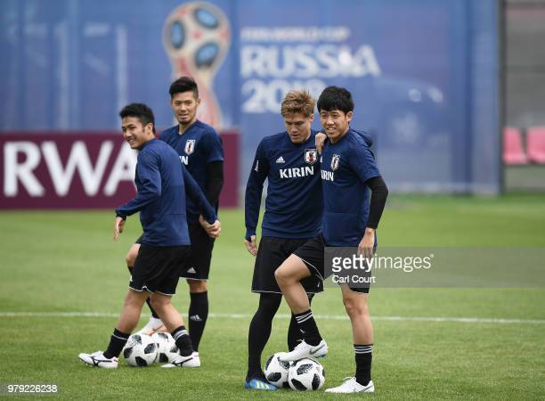 Gotoku Sakai of Japan speaks with Wataru Endo of Japan during a Japan training session during the 2018 FIFA World Cup at the FC Rubin Training Ground...