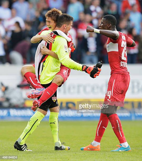 Gotoku Sakai of Stuttgart celebrates victory with Thorsten Kirschbaum and Antonio Ruediger the Bundesliga match between VfB Stuttgart and Hannover 96...