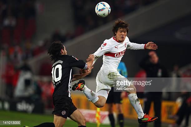 Gotoku Sakai of Stuttgart is challenged by Olcay Sahan of Kaiserslautern during the Bundesliga match between VfB Stuttgart and 1. FC Kaiserslautern...