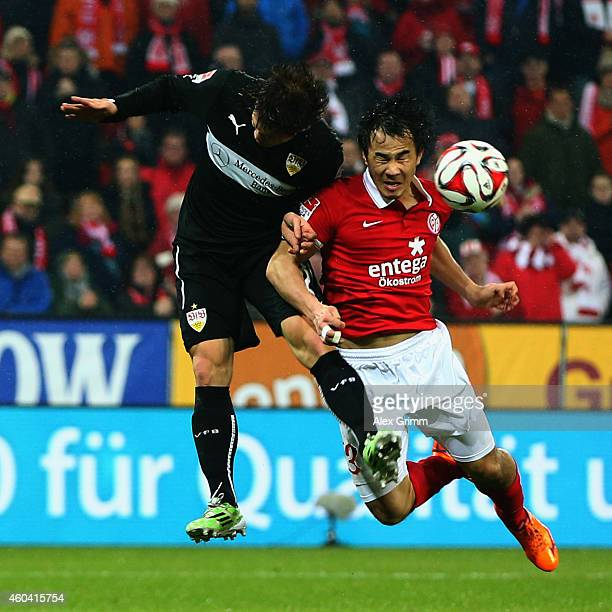 Gotoku Sakai of Stuttgart jumps for a header with Shinji Okazaki of Mainz during the Bundesliga match between 1 FSV Mainz 05 and VfB Stuttgart at...