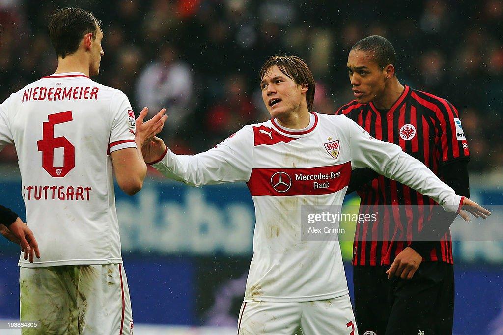 Gotoku Sakai (C) of Stuttgart tries to seperate team mate Georg Niedermeier (L) and Bamba Anderson of Frankfurt during the Bundesliga match between Eintracht Frankfurt and VfB Stuttgart at Commerzbank-Arena on March 17, 2013 in Frankfurt am Main, Germany.