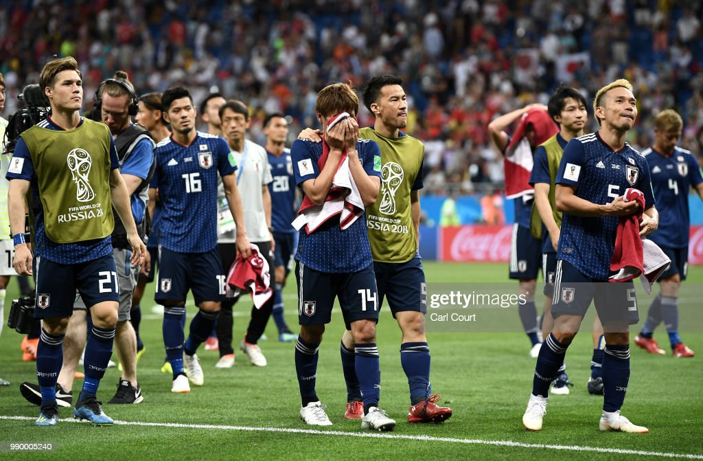 Gotoku Sakai, Takashi Inui, Shinji Okazaki and Yuto Nagatomo of Japan walks off the pitch dejected folowing the 2018 FIFA World Cup Russia Round of 16 match between Belgium and Japan at Rostov Arena on July 2, 2018 in Rostov-on-Don, Russia.