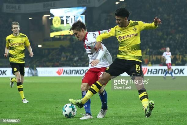 Gotoku Sakaiof Hamburg fights for the ball with Mahmoud Dahoud of Dortmund during the Bundesliga match between Borussia Dortmund and Hamburger SV at...