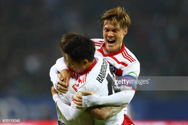 Gotoku Sakai of Hamburg Tatsuya Ito of Hamburg and Dennis Diekmeier of Hamburg after Filip Kostic of Hamburg scored a goal to make it 21 during the...