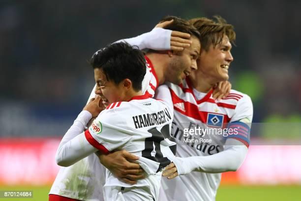 Gotoku Sakaiof Hamburg Tatsuya Ito of Hamburg and Dennis Diekmeier of Hamburg after Filip Kostic of Hamburg scored a goal to make it 21 during the...
