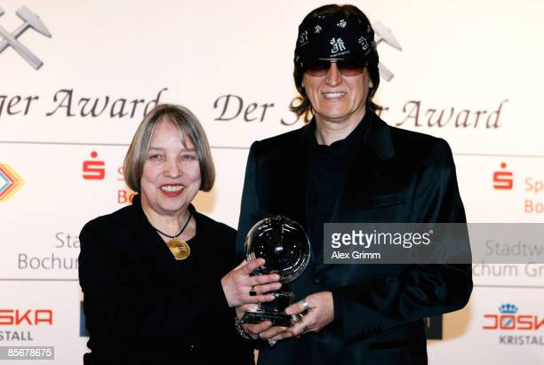 Gottfried Helnwein presents his award with Antje Vollmer during the Steiger Awards ceremony at the Jahrhunderthalle on March 28 in Bochum Germany