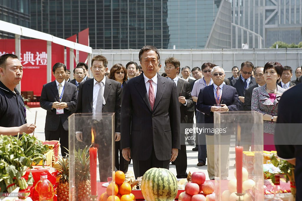 Gou Tai-Ming 'Terry', founder of Foxconn, prays during a ground breaking ceremony at the new China headquarters building at the Lujiazui financial district on May 10, 2012 in Shanghai, China. Apple supplier Foxconn started construction Thursday on its Chinese mainland headquarters in Shanghai.