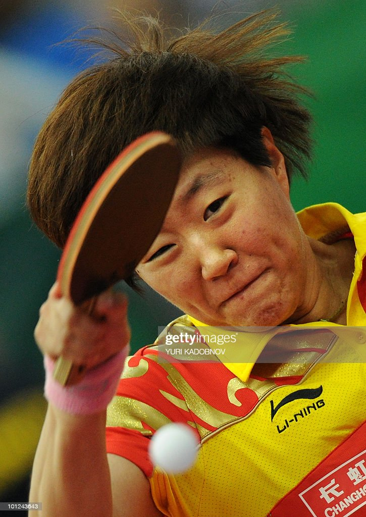 Gou Yan of China returns a serve to Carla Nouwen of the Netherlands during the women's quarter final at the 2010 World Team Table Tennis Championships in Moscow on May 28, 2010.