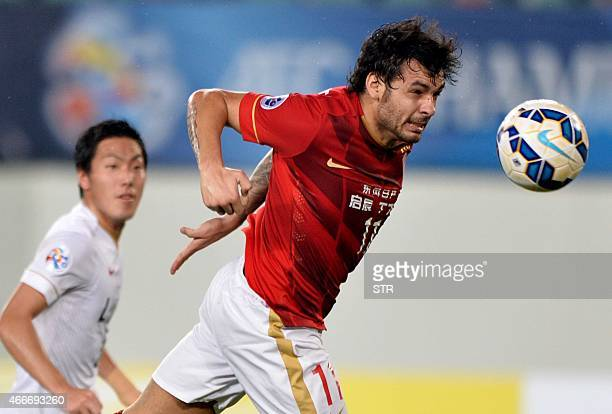 Goulart Pereira of China's Guangzhou Evergrande heads the ball at goal against Japan's Kashima Antlers during their AFC Champions League group H...
