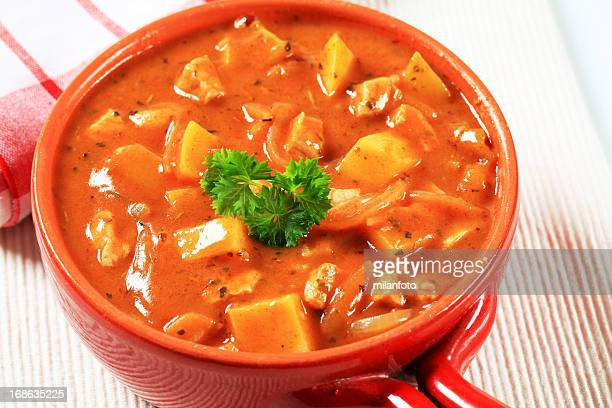 goulash soup in a ceramic bowl - traditionally hungarian stock pictures, royalty-free photos & images