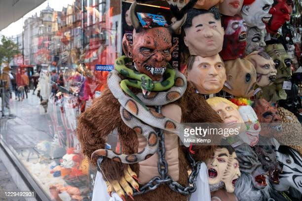 Goulish masks outside a souvenir shop following Halloween as Londoners await the imminent second coronavirus lockdown it's business as usual in the...