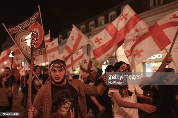 Goup of young Nationalists walk throught Tbilisi center on the day that the country celebrates its Independence Day commemorating the adoption of the...