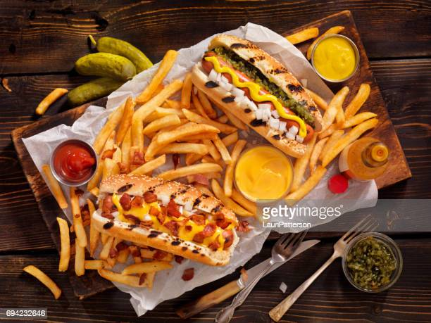 gourmet bbq hotdogs and fries - sausage bap stock photos and pictures