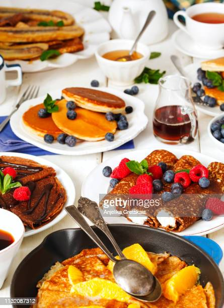 Gourmet breakfast with crepes and pancakes . Crepe Suzette, Chocolate Crepes, Crepes with caramelized fried banana, Crepes with ricotta and Pancakes with fresh berry and maple syrup
