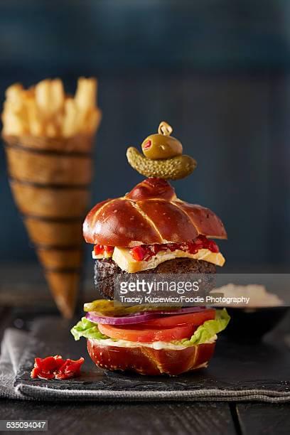 gourmet burger on pretzel bun
