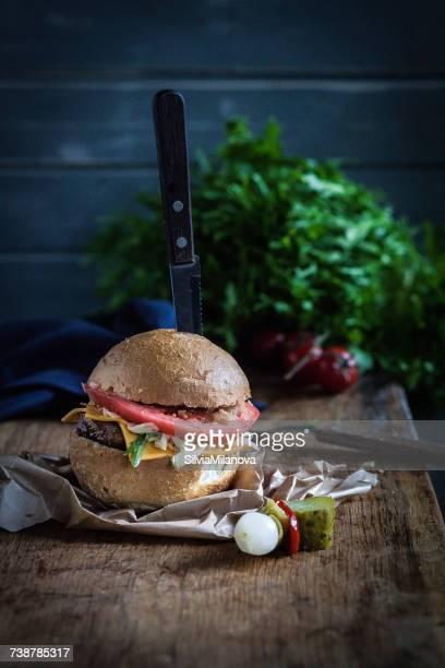 Gourmet Cheeseburger on a chopping board