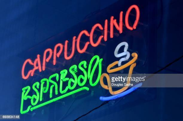 Gourmet coffee shop illuminated neon sign advertising cappuccino and espresso