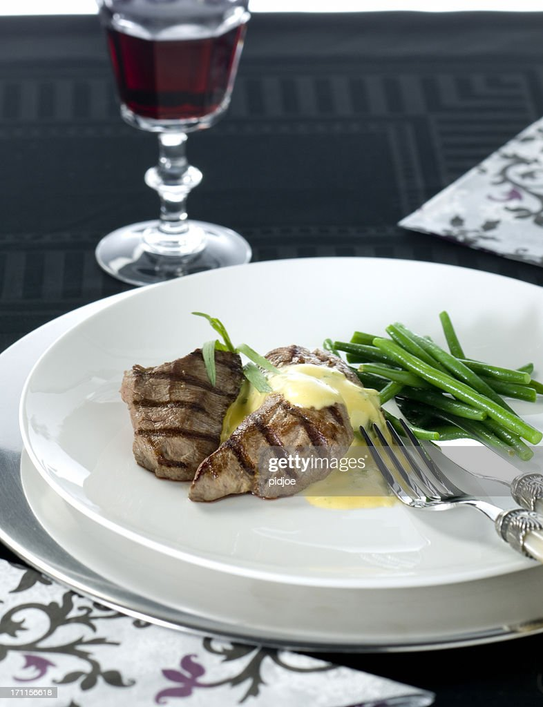 gourmet dish with grilled steak Hollandaise sauce and green beans : Stock Photo
