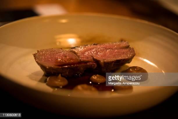 Gourmet dish with lamb, onion & rosemary
