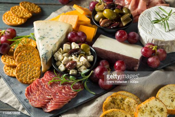 gourmet fancy charcuterie board - charcuterie board stock pictures, royalty-free photos & images