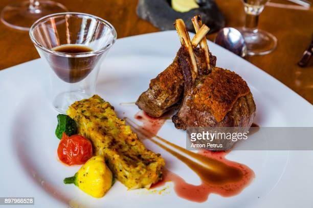 gourmet main entree course grilled rack of lamb - course meal stock pictures, royalty-free photos & images