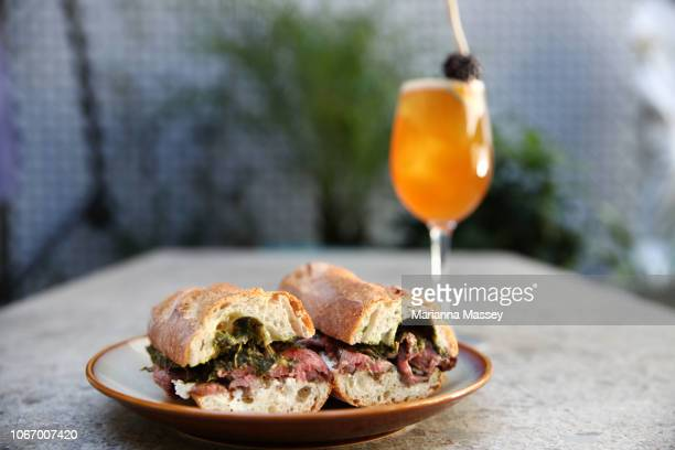 Gourmet Sandwich served with a cocktail at a Cafe