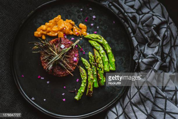 gourmet vegan burger served with grilled asparagus and mango chutney - gourmet stock pictures, royalty-free photos & images