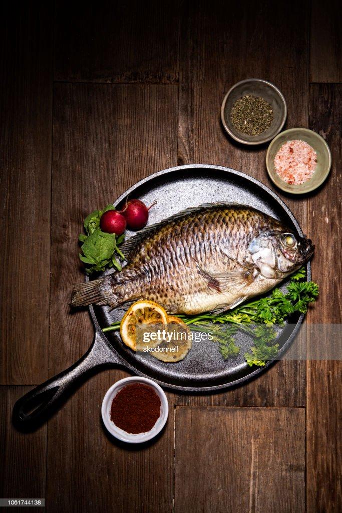 Gourmet Whole Dorado Fish on Metal Skillet Pan : Stock Photo