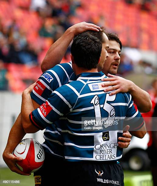 Gouws Prinsloo of Griquas celebrates with Danie Dames of Griquas after he scores a try during the Absa Currie Cup match between Eastern Province...
