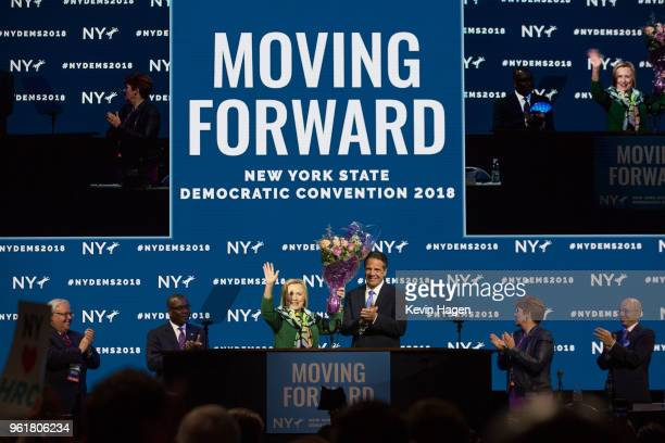 Gov Andrew Cuomo brings flowers after Hillary Clinton's speech during the New York Democratic convention at Hofstra University on May 23 2018 in...
