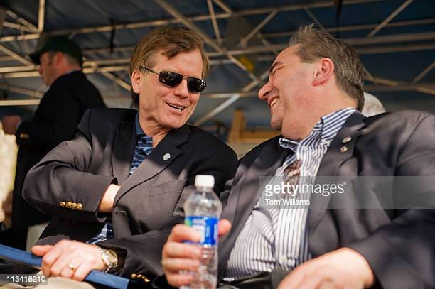 Gov. Bob McDonnell, R-Va., left, has a word with Lt. Gov. Bill Bolling, R-Va., on stage during the 63rd Annual Shad Planking political rally in...
