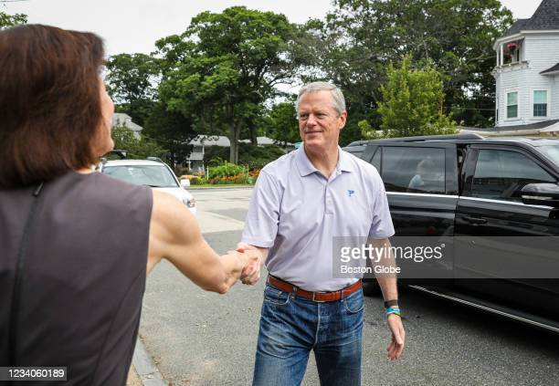 Gov. Charlie Baker shakes the hand of Holly Grant, CEO at American Red Cross of Massachusetts, while arriving with his wife, Lauren, to donate at a...