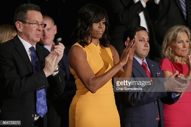 Gov Dannel P Malloy of Connecticut first lady Michelle Obama Naveed Shah of Springfield VA and wife of US Vice President Joe Biden Dr Jill Biden give...