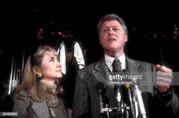 AR Gov Dem presidential candidate Bill Clinton speaking into mikes at fundraiser while wife Hillary stands loyally by his side