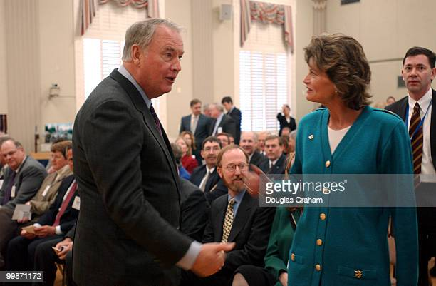 Gov Frank Murkowski RAlaska and his daughter Lisa Murkowski RAlaska during a signing ceremony to renew the Federal Agreement and RightofWay for the...