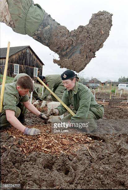 Gov Gen Horseguard Cadets are planting trees for Earth Day at the Markham MuseumLance Corporal Patrick Mathers14 and Corporal Karen Atwellglasses...