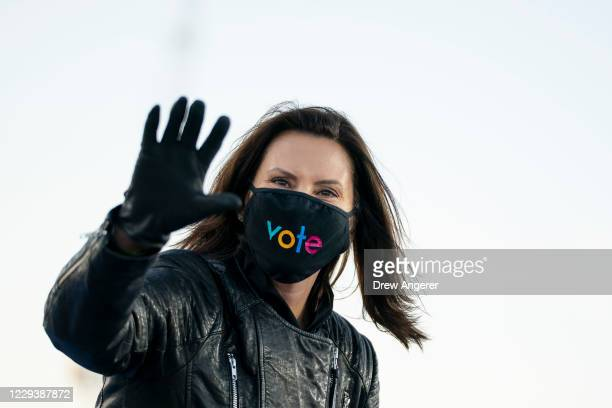 Gov. Gretchen Whitmer arrives for a drive-in campaign rally with Democratic presidential nominee Joe Biden and former President Barack Obama at Belle...