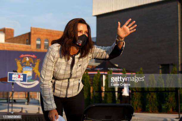 Gov. Gretchen Whitmer waves to the crowd before Democratic U.S. Vice Presidential nominee Sen. Kamala Harris during a voter mobilization event on...