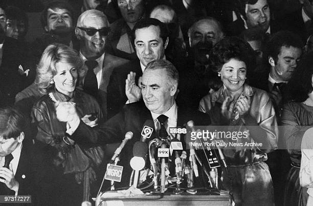 Gov Hugh Carey after his reelection victory speaks to crowd while Anne Ford Mario Cuomo and Mrs Matilda Cuomo cheer him on