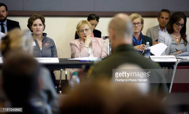 Gov Janet Mills center and Chellie Pingree to her left and other listen to Jason Owens of the US Border Parol during a meeting to discuss the...
