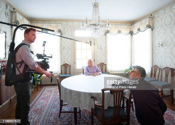 Gov Janet Mills sits at a table in the Blaine House in Augusta while videographer Lindsay Mann left and Maine Poet Laureate Stuart Kestenbaum discuss...